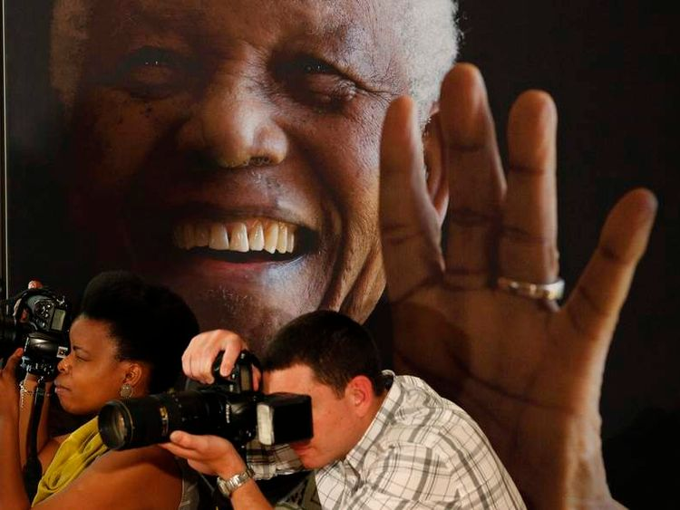 "Photographers take pictures during a news conference with the cast of the biographical film ""Mandela: Long Walk to Freedom"" at the Nelson Mandela Centre of Memory in Johannesburg"