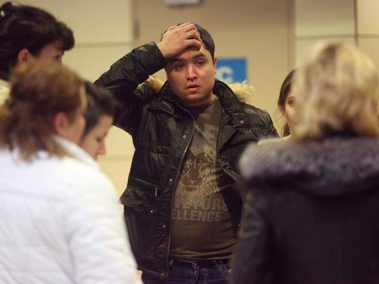 A man reacts at Kazan airport, where a Tatarstan Airlines Boeing 737 crashed