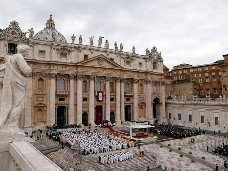 Bone fragments supposedly belonging to St Peter are placed on the altar at a Mass in St Peter's Square
