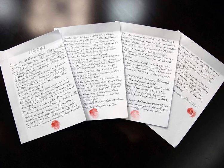 """KCNA handout shows a four-page document entitled """"Apology"""" supposedly written by U.S. citizen Merrill E. Newman"""