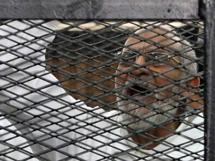 Muslim Brotherhood leader Mohammed Badie shouts slogans from the defendant's cage during his trial with other leaders of the Brotherhood in a courtroom in Cairo