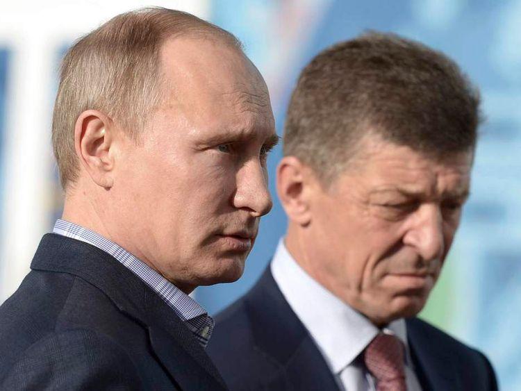 Russian President Vladimir Putin and Deputy Prime Minister Dmitry Kozak visit the Olympic media centre in Sochi