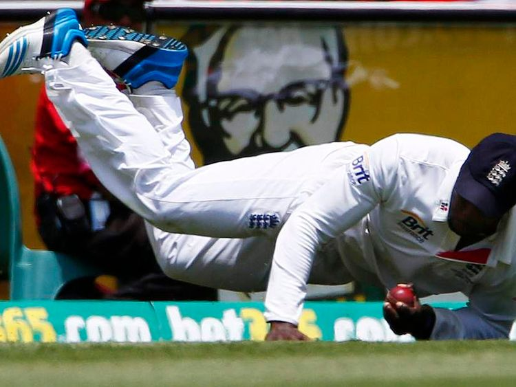 England's Carberry takes a catch to dismiss Australia's Harris during the third day of the fifth Ashes cricket test at the Sydney cricket ground