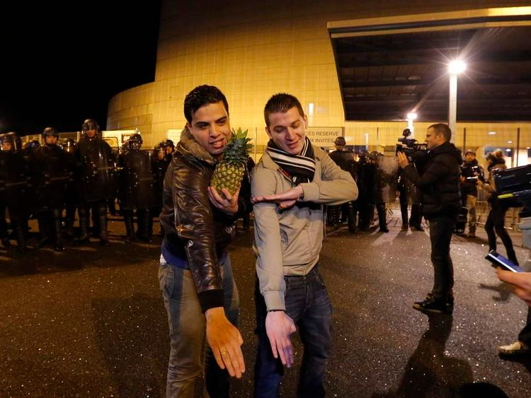 """Youths make a gesture, the """"quenelle"""" outside the Zenith concert hall where French humorist Dieudonne M'bala M'bala, also known as Dieudonne, is to hold his show in Nantes"""