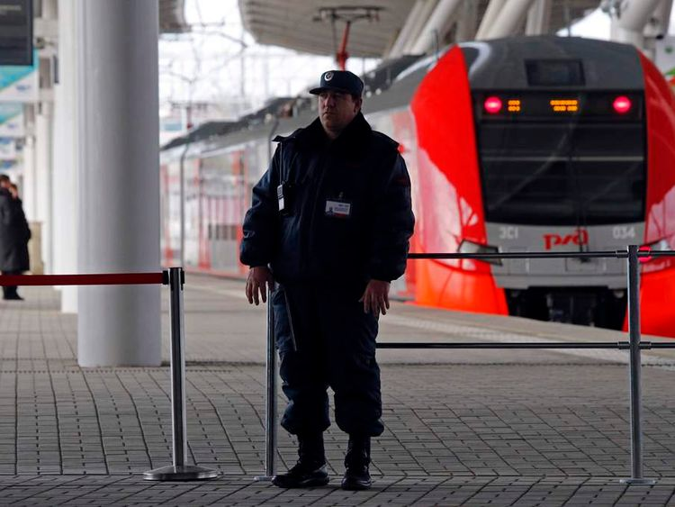 A police officer stands guard at a train station in Sochi