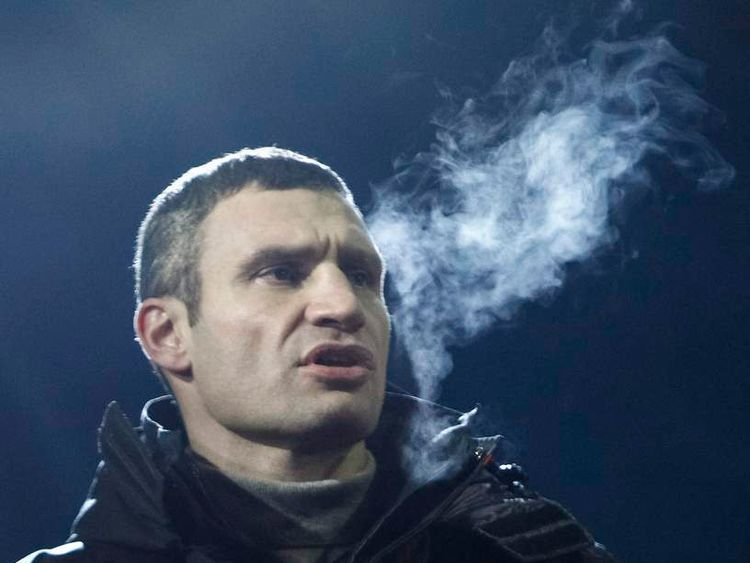 Opposition leader Vitaly Klitschko attends a rally in Independence square in Kiev