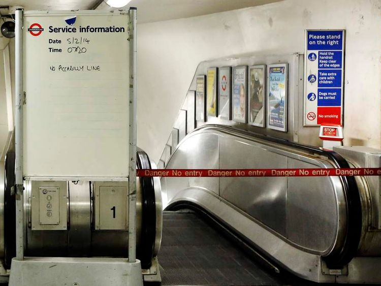 "A service information board states ""No Piccadilly Line"" tube trains during strikes at Green Park underground station in London"