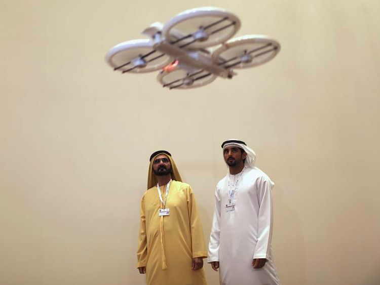 United Arab Emirates' Prime Minister and Ruler of Dubai Sheikh Mohammed bin Rashid al-Maktoum and his son Dubai's Crown Prince Sheikh Hamdan bin Mohammed al-Maktoum watch an unmanned aerial drone during Virtual Future Exhibition, in Dubai
