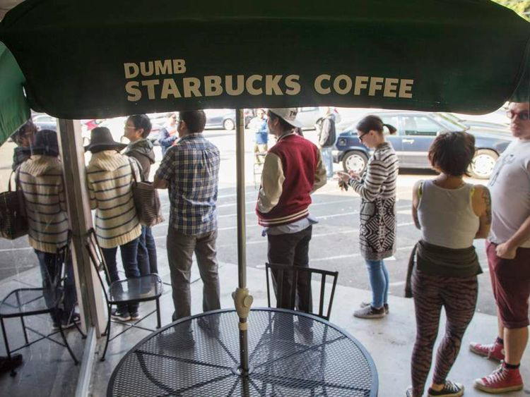 "People line up outside ""Dumb Starbucks"", a parody store of the Starbucks Coffee chain, in Los Angeles"