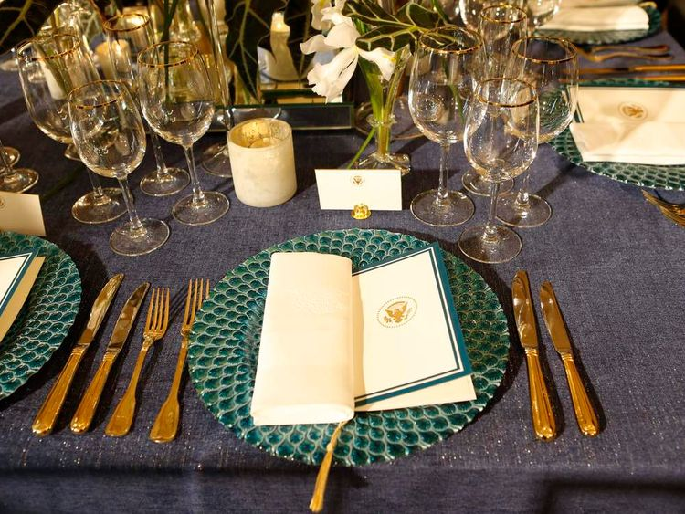 A place setting is displayed during a media preview of Tuesday's state dinner to honor French President Hollande in Washington