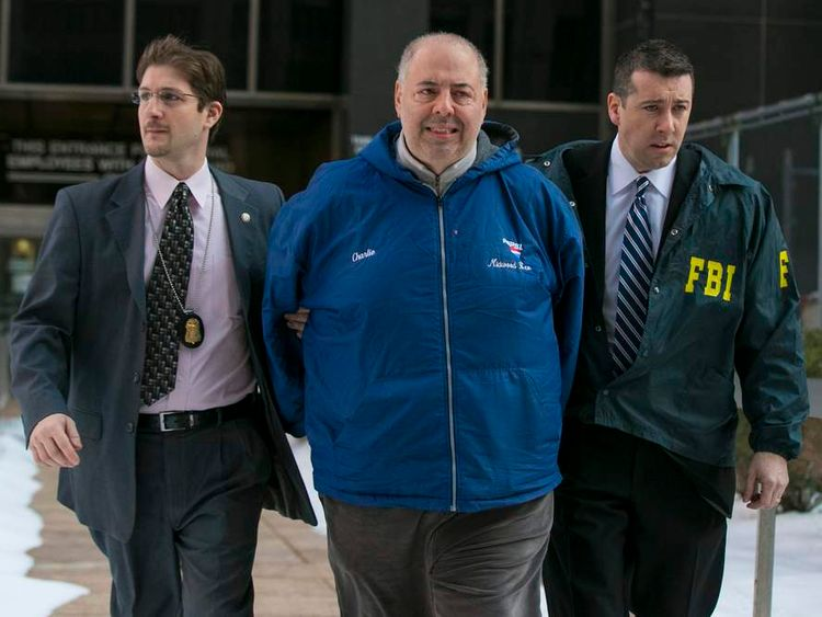 "Bonanno family associate Charles Centaro (C ), also known as ""Charlie Pepsi"", is escorted by FBI agents from their Manhattan offices in New York"