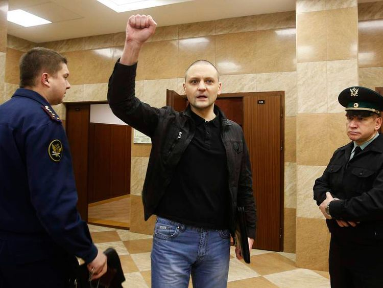 Opposition leader Udaltsov gestures as he arrives at court to attend a hearing in Moscow