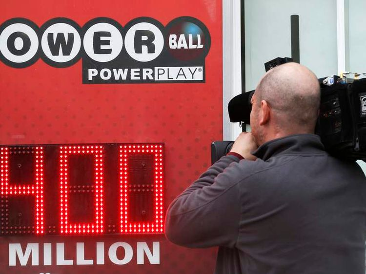 A cameraman films a Powerball sign in Virginia