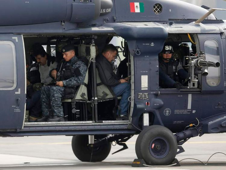 "Joaquin ""Shorty"" Guzman is seen sitting inside a Mexican federal police helicopter at the Navy's airstrip in Mexico City"