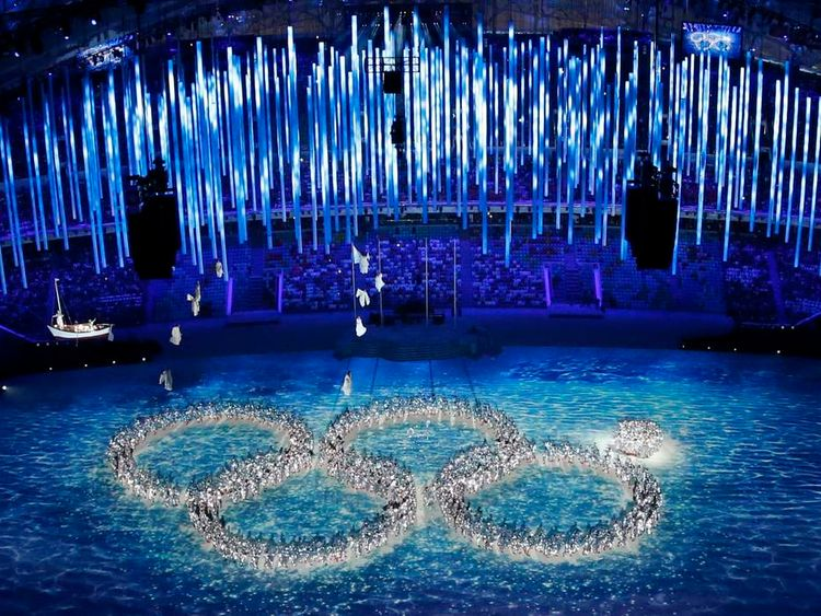Performers form the Olympic rings during a show at the closing ceremony for the 2014 Sochi Winter Olympics.