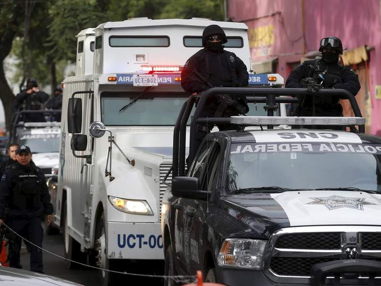 A convoy of federal police and a prison truck in Mexico City
