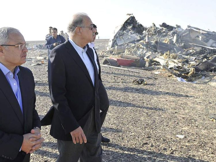 Egypt's Prime Minister Sherif Ismail (2nd L) and Tourism Minister Hisham Zaazou look at the remains of a Russian airliner which crashed in central Sinai near El Arish city