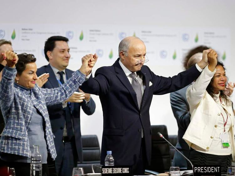 French PForeign Affairs Minister Laurent Fabius, President-designate of COP21,  Christiana Figueres react at the World Climate Change Conference 2015 (COP21) at Le Bourget