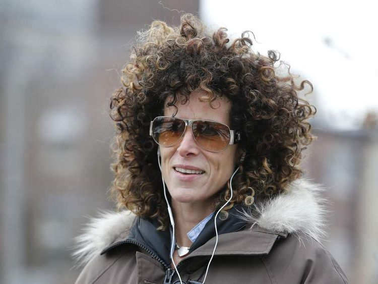 Andrea Constand walks in a park in Toronto