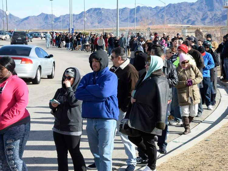 Hundreds of people wait in line to purchase tickets for the Powerball lottery at the CA lotto store in San Bernardino County, California