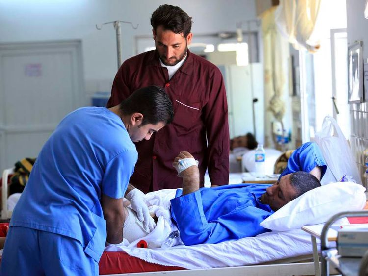 A man who was injured in Tuesday's clash between Iraqi troops and demonstrators receives treatment in a hospital in Arbil