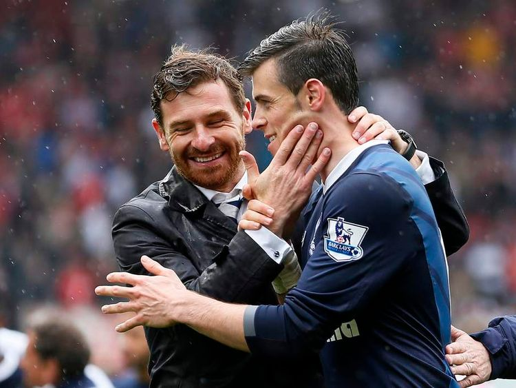 Tottenham Hotspur manager Villas-Boas celebrates with Bale after winning their English Premier League soccer match against Stoke City at the Britannia Stadium in Stoke-on-Trent