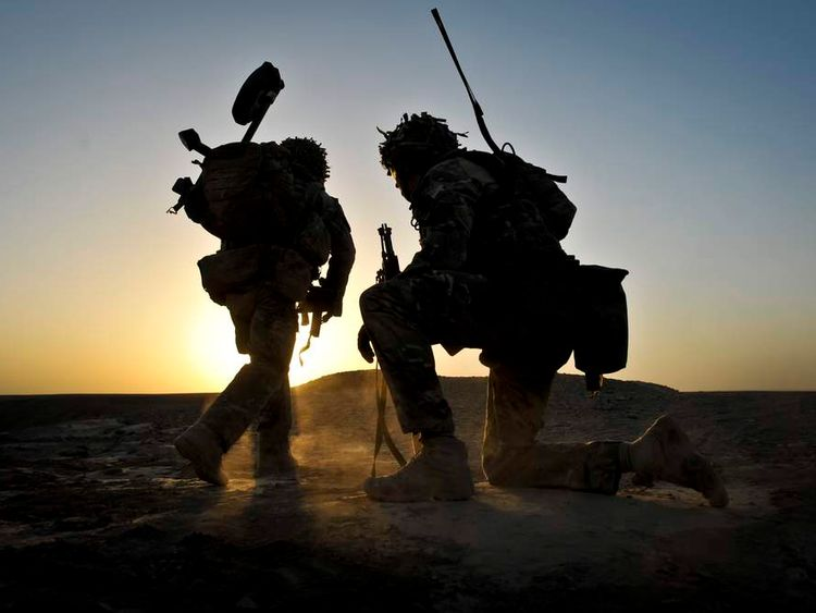 Soldiers from the 1st Battalion Royal Regiment Fusiliers conducting a dawn foot patrol in Helmand Province, Afghanistan
