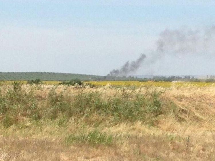 Smoke is seen at the Moron air base following a plane crash.