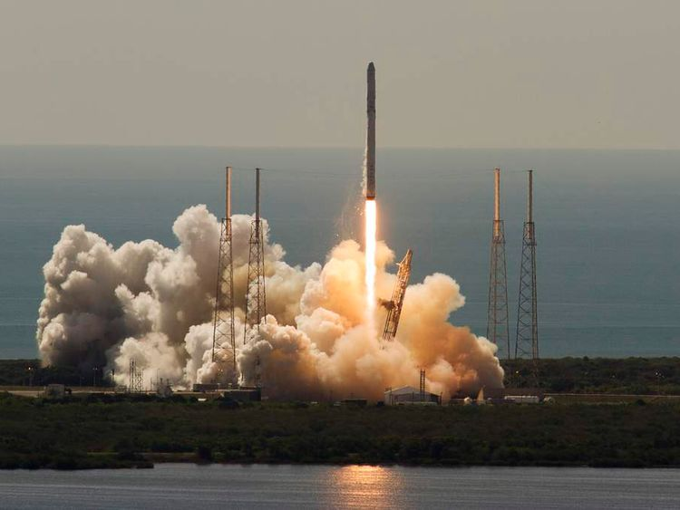 An unmanned SpaceX Falcon 9 rocket launches from Cape Canaveral