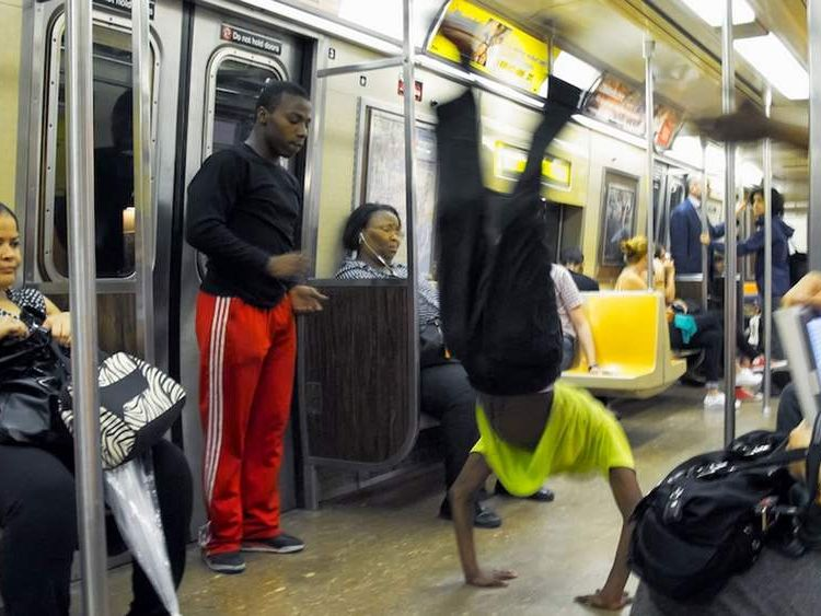 010714 $$ New York Police Flip Over Subway Acrobats