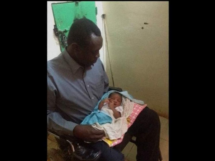 Daniel Wani with his new baby daughter