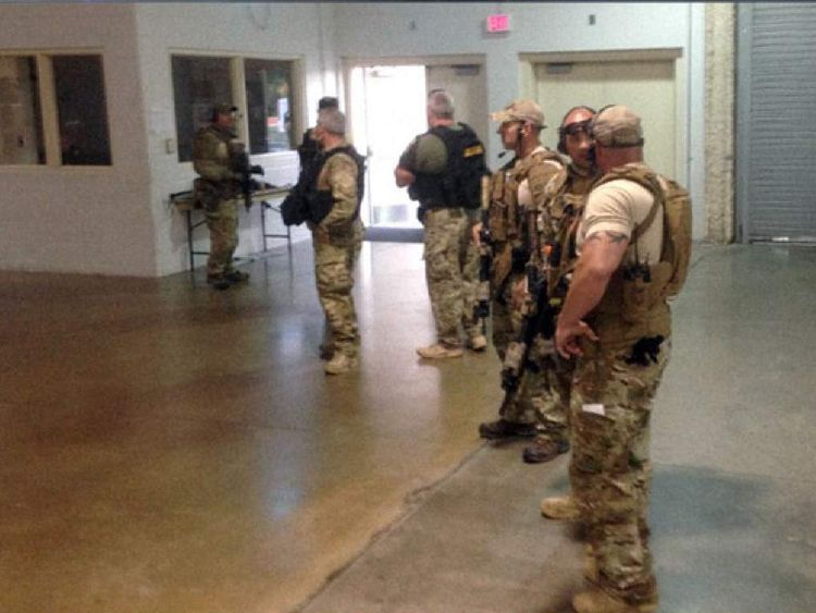 A Swat team arrives at the conference hall