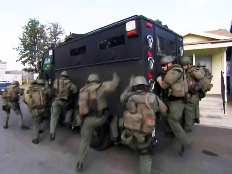 Heavily-armed SWAT team responding to hoax call
