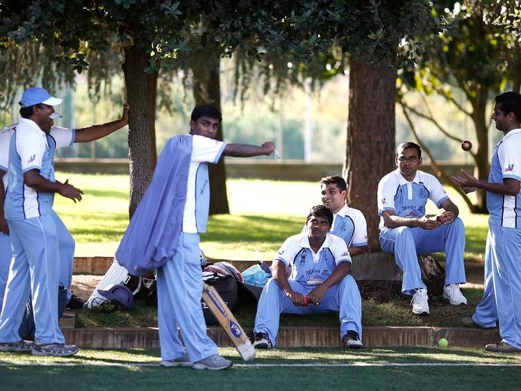 Players from a team of priests and seminarians at a cricket training session
