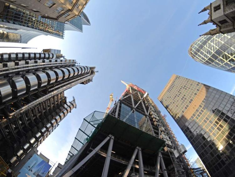 The Lloyds TSB building (L) and Gherkin (R)
