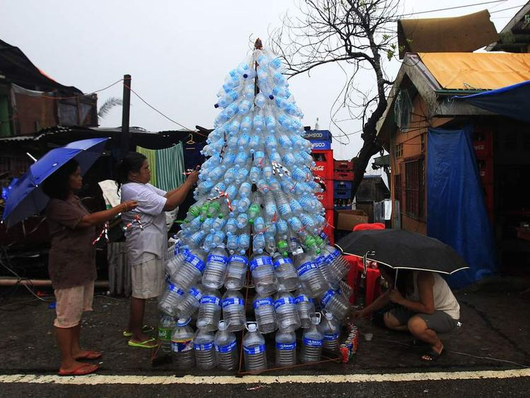 Victims of super Typhoon Haiyan decorate their improvised Christmas tree