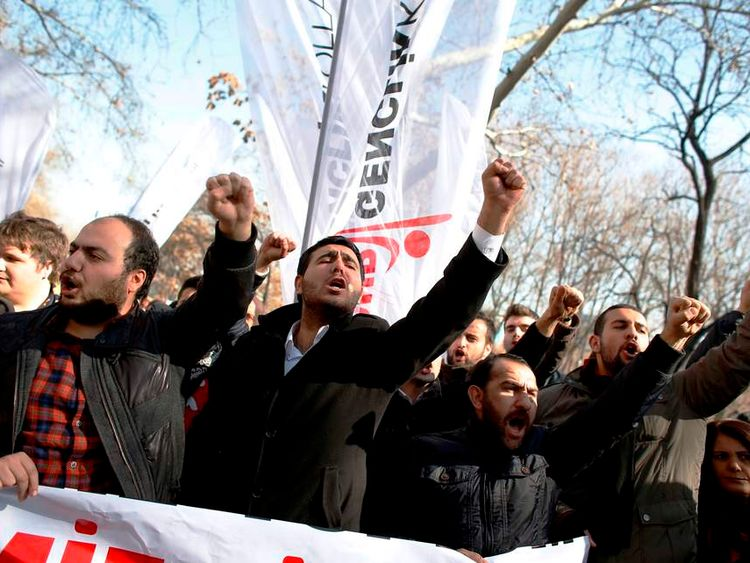 Protesters shout slogans against Turkey's Prime Minister Tayyip Erdogan