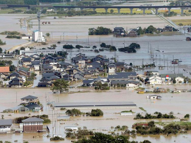 An aerial view shows flooded residential areas along the Katsura river as the river overflooded caused by tropical storm Man-yi, also called locally Typhoon No.18, in Kyoto
