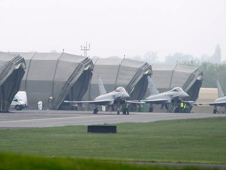 Typhoon jets taxi to their hangers at RAF Northolt in west London
