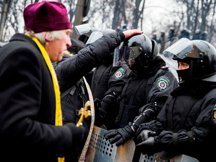 Clerics bless riot police officers