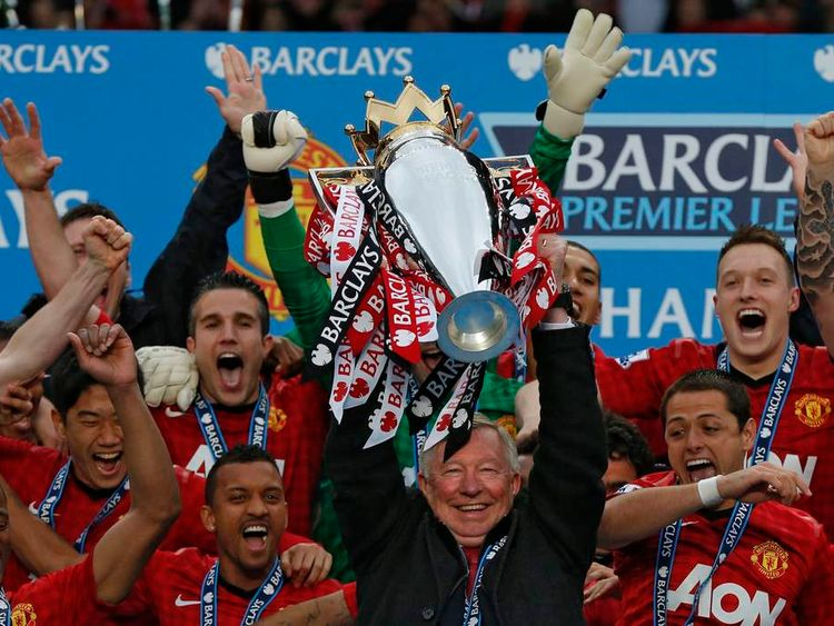 Alex Ferguson lifts the English Premier League trophy at Old Trafford stadium in Manchester