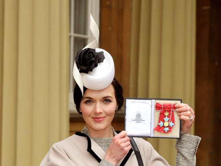 Victoria Pendleton holds her Commander of the British Empire (CBE) award at Buckingham Palace in central London.