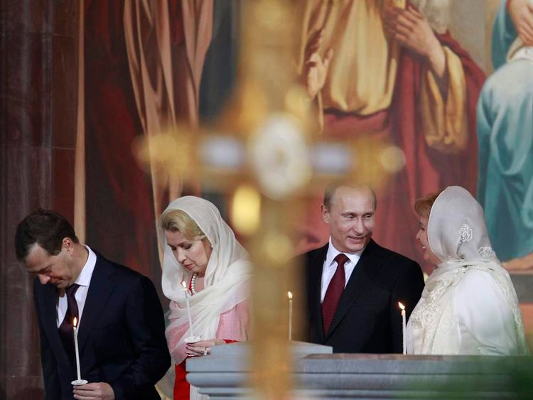 Russian President Medvedev, first lady Svetlana, Prime Minister Putin and his wife Lyudmila attend an Orthodox Easter service in the Christ the Saviour Cathedral in Moscow