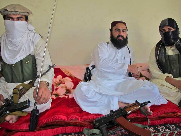 Wali-ur-Rehman, deputy Pakistani Taliban leader, who is flanked by militants speaks to a group of reporters in Shawal town