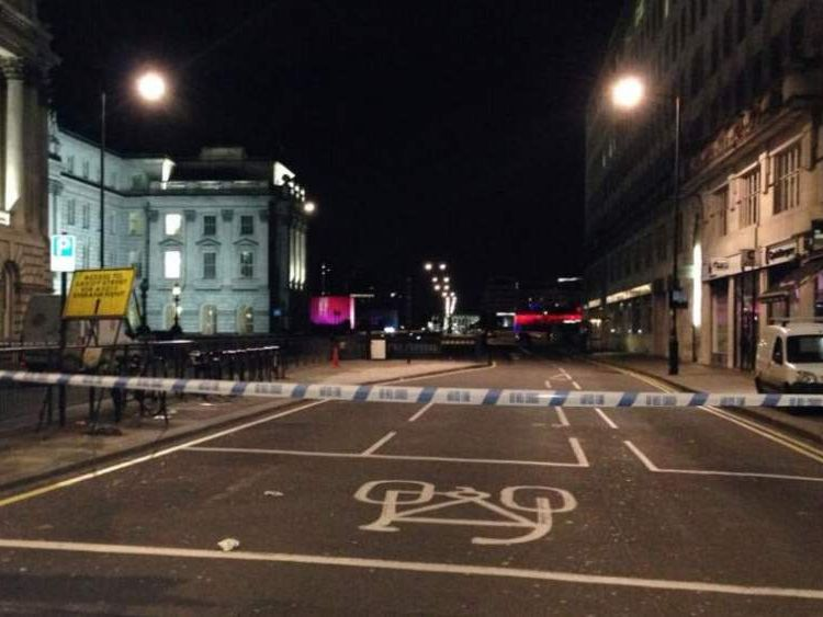 Police seal off a road close to the scene where a man was shot in a drive-by attack close to Waterloo Bridge.
