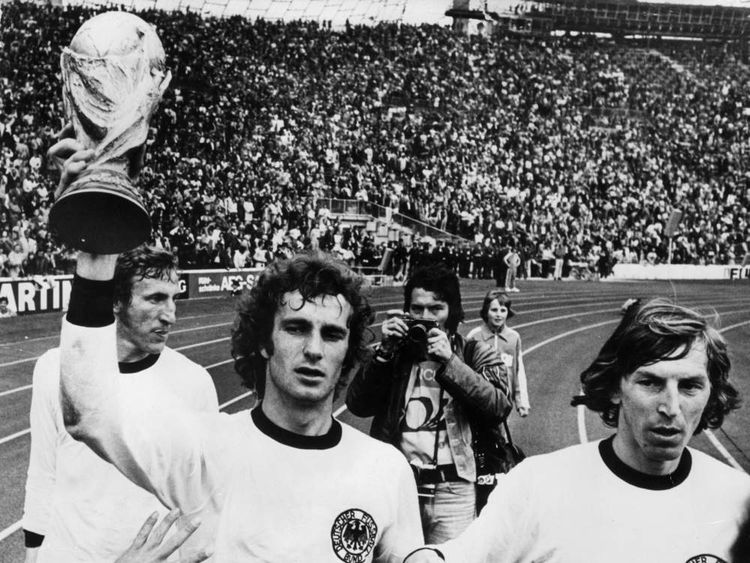 West Germany players lift the 1974 World Cup.