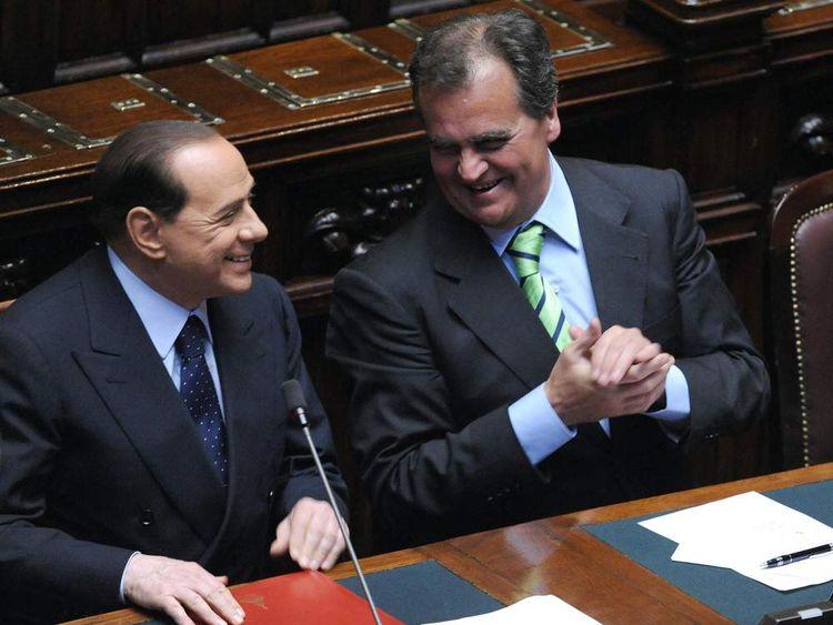 Silvio Berlusconi (L) and Roberto Calderoli (R)