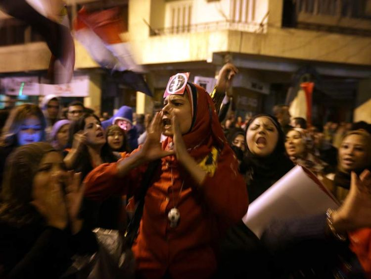 Egyptian opposition supporters shout slogans outisde the Presidential Palace in Cairo