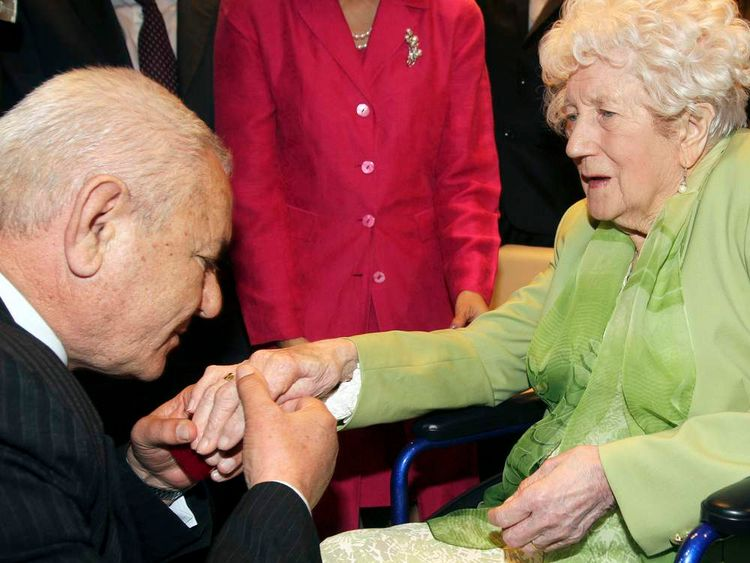 Albanian Xhemil Cala puts the ring on Dorothy Webster's finger
