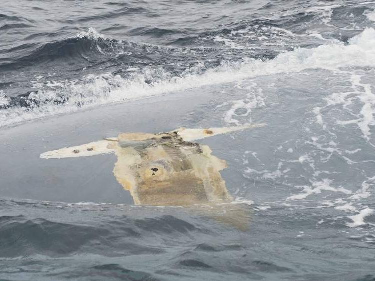 overturned hull of Cheeki Rafiki. Pic: US Coast Guard District 1